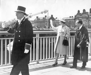 The Queen, Elizabeth 11. 1966 visit.Mr John Finlay carries the Belfast Corporation mace in the reverse position as he leads the Queen and party over the bridge. The mace is reversed when the Sovereign is present.  4/7/1966