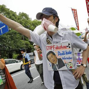 Anti-nuclear demonstrators shout slogans during a march in Tokyo (AP)