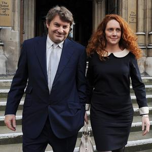 Former News of the World Editor Rebekah Brooks with her husband Charlie Brooks, after giving evidence to the Leveson Inquiry
