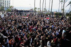 In this photo taken Friday, Jan.28, 2011, a crowd demonstrate in Alexandria, Egypt. Thousands of Alexandrians met to pray Sunday Jan 30 in downtown Alexandria, a Mediterranean port city that is a stronghold of the Muslim Brotherhood. After prayers, the crowd marched towards the city's old mosque to pray for the souls of those who died in the protests. (AP Photo/Tarek Fawzi)