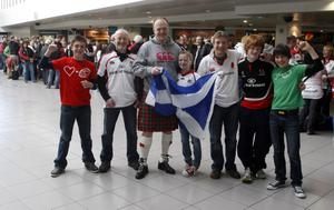 Ewan MacDonald and his daughter Elen with Ulster fans waiting on their train at Belfast Central Station