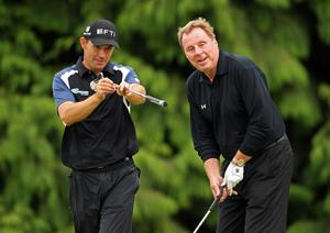 Padraig Harrington offers some advice to Harry Redknapp, Tottenham FC manager,  during the second round of The JP McManus Invitational Pro-Am event at the Adare Manor Hotel and Golf Resort on July 6, 2010 in Limerick