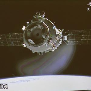 A Chinese spacecraft carrying three astronauts has carried out a manual docking with an orbiting module (AP)