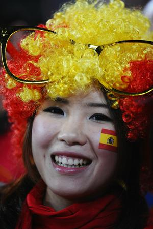 A Spain fan enjoys the atmosphere prior to the 2010 FIFA World Cup South Africa Final match between Netherlands and Spain at Soccer City Stadium on July 11, 2010 in Johannesburg, South Africa