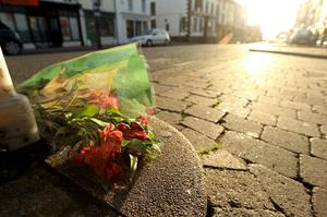 Floral tributes lie at the scene of a murder caused by gunman Derrick Bird on June 2, 2010 in Whitehaven, England