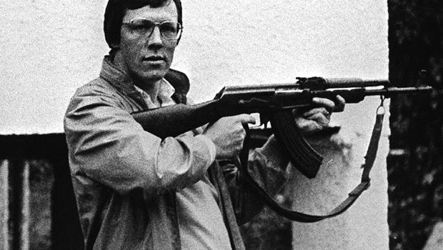 Peter Robinson of the DUP pictured in the Israeli Border Area with AK47 rifles while on a fact finding mission to the Middle East. Pacemaker Press Intl. Dec. 1984