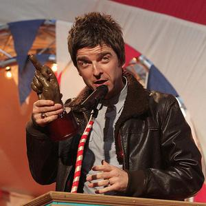 Noel Gallagher collects the Godlike Genius Award at the NME Awards