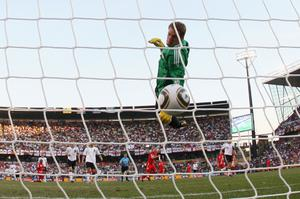 Manuel Neuer of Germany watches the ball bounce over the line from a shot that hit the crossbar from Frank Lampard of England, but referee Jorge Larrionda judged the ball did not cross the line during the 2010 FIFA World Cup South Africa Round of Sixteen match between Germany and England at Free State Stadium on June 27, 2010 in Bloemfontein, South Africa