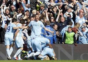 Feeling blue: Manchester City's fans went through a wide range of emotions but none of them will ever forget the moment Sergio Aguero scored the late, late winner
