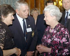 Britain's Queen Elizabeth II meets William King from Northern Ireland, Tuesday December 7, 2004, who was invited for his services to competition ploughing at a Christmas reception at Buckingham Palace.