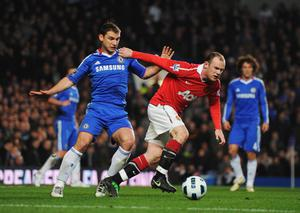LONDON, ENGLAND - MARCH 01:   Branislav Ivanovic of Chelsea challenges Wayne Rooney of Manchester United during the Barclays Premier League match between Chelsea and Manchester United at Stamford Bridge on March 1, 2011 in London, England.  (Photo by Clive Mason/Getty Images)
