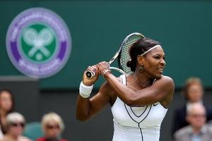 Venus Williams reaches for a forehand on the way to winning her second round thriller Kimiko Date-Krumm yesterday