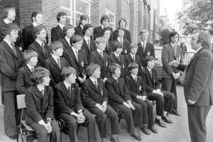 The successful madrigal group from Bangor Grammar School are put through their paces by their director of music Ian Hunter, 1975.