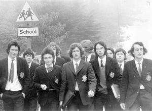 Pupils, who refused to obey the short back and sides ruling on their way home from school, 1973.