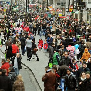 The road and pavements of Oxford Street in central London are packed with Christmas shoppers