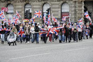 Oprotesters converge on Belfast City Hall on Saturday afternoon after the removal of the Union flag earlier this week