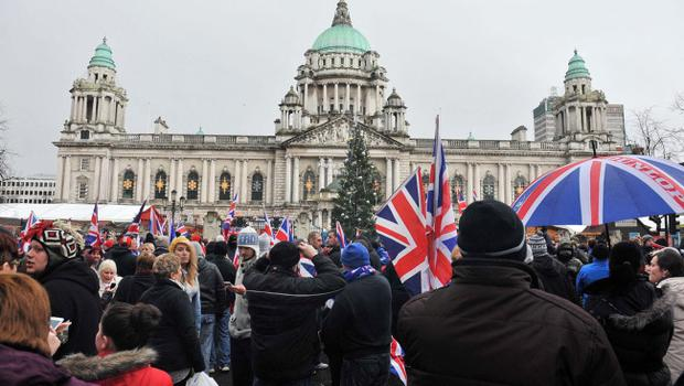 Protesters converge on Belfast City Hall on Saturday afternoon after the removal of the Union flag earlier this week