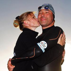 David Walliams received a well-earned kiss from his wife Lara Stone after completing his swim