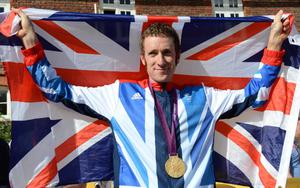 Great Britain's Bradley Wiggins poses for the press after winning the Men's Individual Time Trial on day five of the London Olympic Games at Hampton Court Palace, London