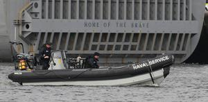 Irish Naval personnel provide security for the US Navy Ship USS Fort McHenry in Dublin port