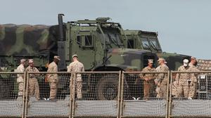 US armed forces personnel are seen on the US Navy Ship USS Fort McHenry in Dublin port