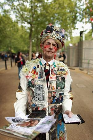 LONDON, ENGLAND - APRIL 28:  Royal family fan William Willis walks along the Mall wearing a suit covered in images of Prince William, Catherine Middleton and other members of the royal family on April 28, 2011 in London, England. With less than 24 hours to go final preparations for the wedding of Prince William and Catherine Middleton are in place.  (Photo by Oli Scarff/Getty Images) *** Local Caption *** William Willis;