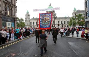 12/7/11 Mandatory Credit Darren Kidd/Presseye.com Orangemen take part in Twelfth of July parades as they make their way to the field at Shaws Bridge, Belfast.The parade makes its way Royal Av