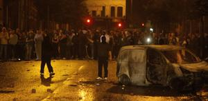 11.07.11. PICTURE BY DAVID FITZGERALDRiots kick off at Broadway in West Belfast as the Police had a perimeter to hold off youths who burnt a car and threw bricks and bottles at the Police