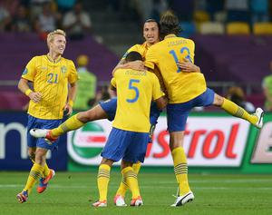 KIEV, UKRAINE - JUNE 19:  Zlatan Ibrahimovic of Sweden celebrates his goal with Jonas Olsson (R) and Martin Olsson as Christian Wilhelmsson (L) looks on during the UEFA EURO 2012 group D match between Sweden and France at The Olympic Stadium on June 19, 2012 in Kiev, Ukraine.  (Photo by Lars Baron/Getty Images)