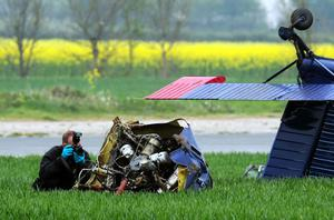 An investigator looks at wreckage of the light aircraft