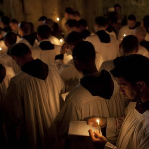 Catholic clergy attend a procession during Good Friday inside the Church of the Holy Sepulchre (AP)