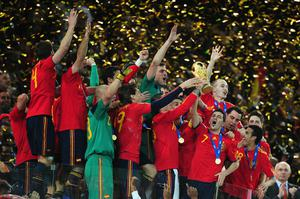 David Villa and Sergio Ramos of Spain lift the World Cup trophy as the Spain team celebrate victory following the 2010 FIFA World Cup South Africa Final match between Netherlands and Spain at Soccer City Stadium on July 11, 2010