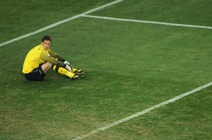 Maarten Stekelenburg of the Netherlands looks dejected as Andres Iniesta of Spain scores the opening goal late into extra time during the 2010 FIFA World Cup South Africa Final match between Netherlands and Spain at Soccer City Stadium on July 11, 2010 in Johannesburg, South Africa