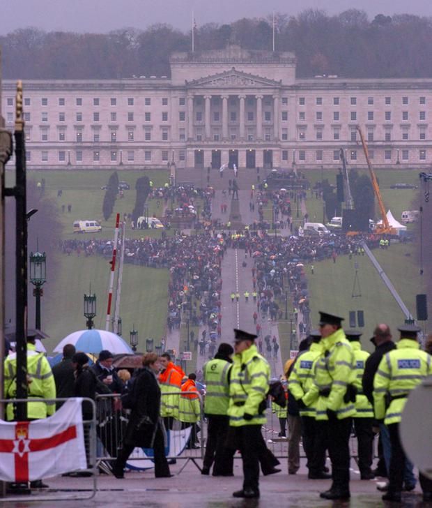 Crowds gather at Stormont for the funeral of George Best
