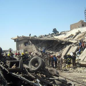 A collapsed building at the site of a bombing in Baghdad, Iraq (AP)
