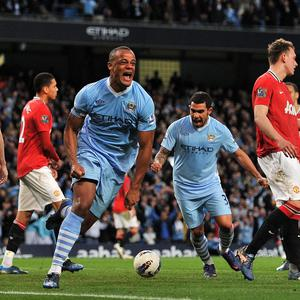 Manchester City's Vincent Kompany celebrates scoring his team's winning against Manchester United