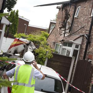 A light aircraft crashed into two houses in Newlands Avenue, Salford (GMP/PA)