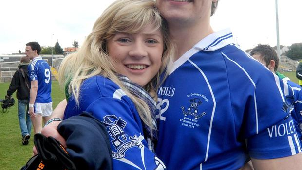 St Colman's player Peter O'Keefe gets a hug from girlfriend Lulu Boyd following the MacRory Cup Final