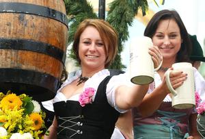 MUNICH, GERMANY - SEPTEMBER 19:  Young women greet with beer mugs during the opening parade of the Oktoberfest beer festival on September 19, 2009 in Munich, Germany. Oktoberfest is Germany's and the world largest fair. About six million people attend the sixteen-day festival during late September and early October.  (Photo by Johannes Simon/Getty Images)