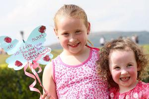 2nd May 2010.  Children's festival in the Waterworks in north Belfast.  Julie Ann Turley(8) with her sister Aimee Smith Turley(3) from the Newlodge.