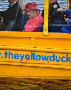 LIVERPOOL, ENGLAND - MAY 17:  Queen Elizabeth II takes a ride on the Yellow Duck amphibious vehicle around Albert Dock during a visit to Merseyside Maritime Museum  (Photo by Christopher Furlong/Getty Images)