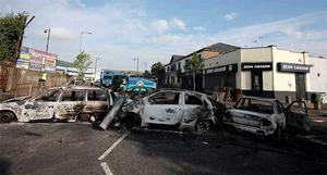 The clean-up operation begins yesterday after rioting in the Ardoyne area on the Twelfth
