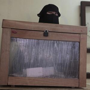 An Egyptian official attends a polling station in Giza (AP)