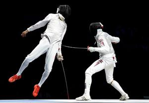 LONDON, ENGLAND - JULY 31:  Sheng Lei (L) of China competes in the Men's Foil Individual Gold Medal Bout against Alaaeldin Abouelkassem of Egypt on Day 4 of the London 2012 Olympic Games at ExCeL on July 31, 2012 in London, England.  (Photo by Lars Baron/Getty Images) ***BESTPIX***