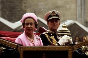 07/06/1977 Queen Elizabeth II and the Duke of Edinburgh in the open landau as they drive on the return processional drive to Buckingham Palace after lunch at the Guildhall to celebrate the Silver Jubilee. PRESS ASSOCIATION Photo.