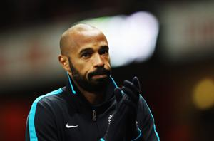 LONDON, ENGLAND - JANUARY 09:  Thierry Henry of Arsenal warms up on the touchline during the FA Cup Third Round match between Arsenal and Leeds United at the Emirates Stadium on January 9, 2012 in London, England.  (Photo by Clive Mason/Getty Images)