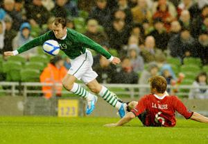 Republic of Ireland's Aidan McGeady skips over Norway's John Arne Riise during the International Friendly at the AVIVA Stadium, Dublin, Ireland. PRESS ASSOCIATION Photo. Picture date: Wednesday November 17, 2010. See PA story SOCCER Republic. Photo credit should read: Barry Cronin/PA Wire.
