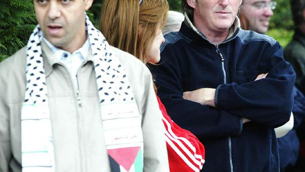 Actor Adrian Dunbar (right) joins protestors gather outside the Israeli Embassy in Dublin