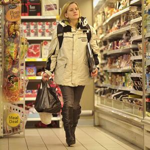 An actress holding a pizza in the Tesco store where Joanna Yeates was seen on the day she went missing