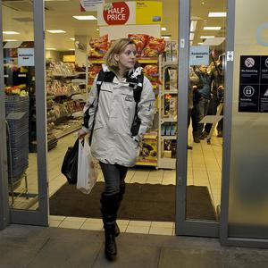 An actress leaves the Tesco store where Joanna Yeates was last seen as part of a reconstruction of her last known movements in Bristol